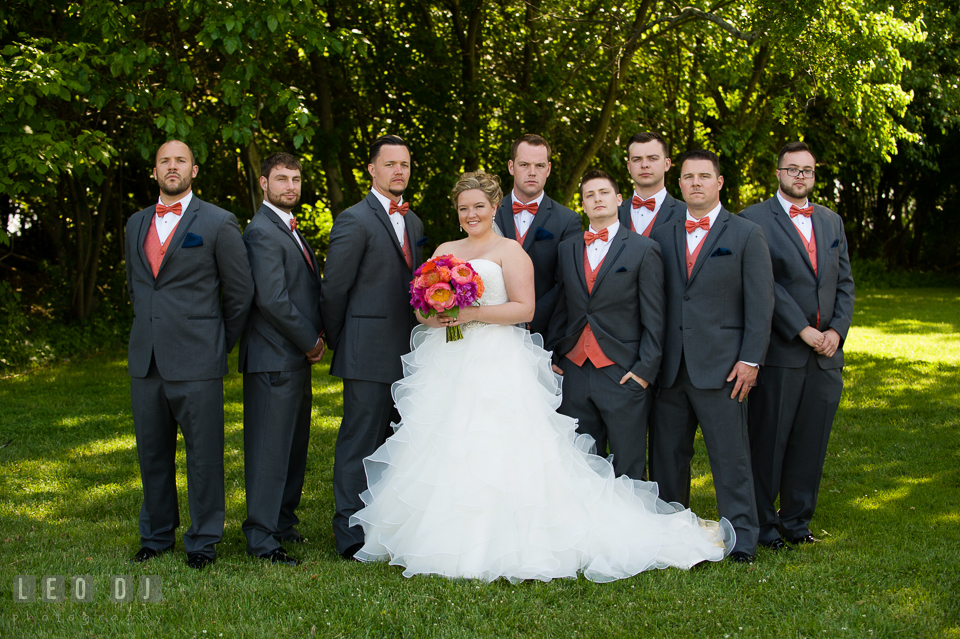 Bride posing together with the Best Man and Groomsmen. Kent Manor Inn, Kent Island, Eastern Shore Maryland, wedding ceremony and getting ready photos, by wedding photographers of Leo Dj Photography. http://leodjphoto.com