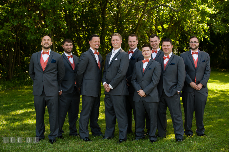 Groom posing together with Best Man and Groomsmen, wearing tux from Vera Wang. Kent Manor Inn, Kent Island, Eastern Shore Maryland, wedding ceremony and getting ready photos, by wedding photographers of Leo Dj Photography. http://leodjphoto.com
