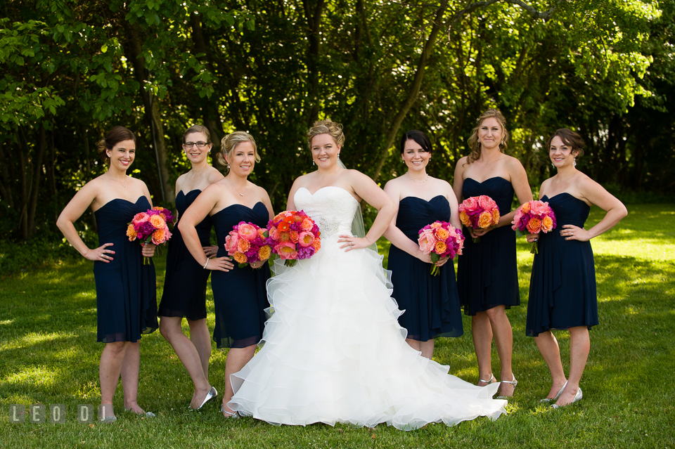Bride posing together with Matron of Honor and Bridesmaids with their flower bouquets. Kent Manor Inn, Kent Island, Eastern Shore Maryland, wedding ceremony and getting ready photos, by wedding photographers of Leo Dj Photography. http://leodjphoto.com