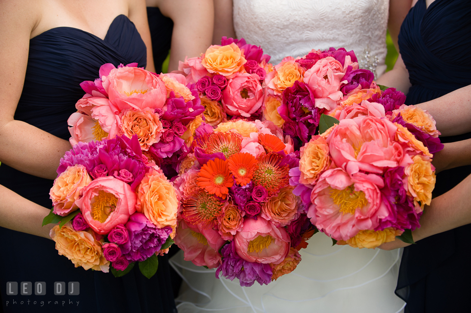 Bride and her Bridal party showing their beautiful flower bouquets designed by Intrigue Design and Decor. Kent Manor Inn, Kent Island, Eastern Shore Maryland, wedding ceremony and getting ready photos, by wedding photographers of Leo Dj Photography. http://leodjphoto.com