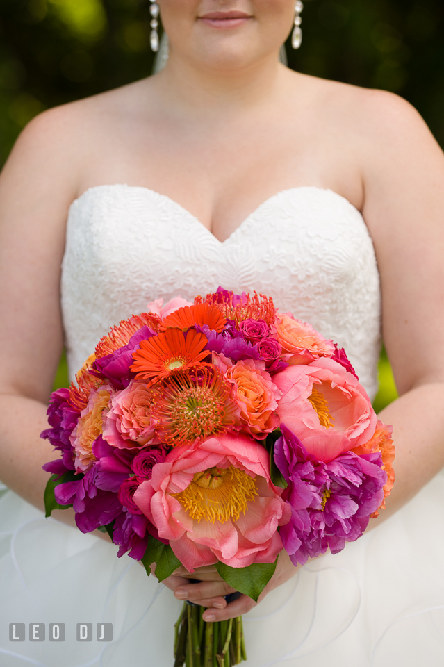 Bride's beautiful flower bouquet - full of peonies, roses, gerberas, and proteas, was designed by Intrigue Design and Decor. Kent Manor Inn, Kent Island, Eastern Shore Maryland, wedding ceremony and getting ready photos, by wedding photographers of Leo Dj Photography. http://leodjphoto.com