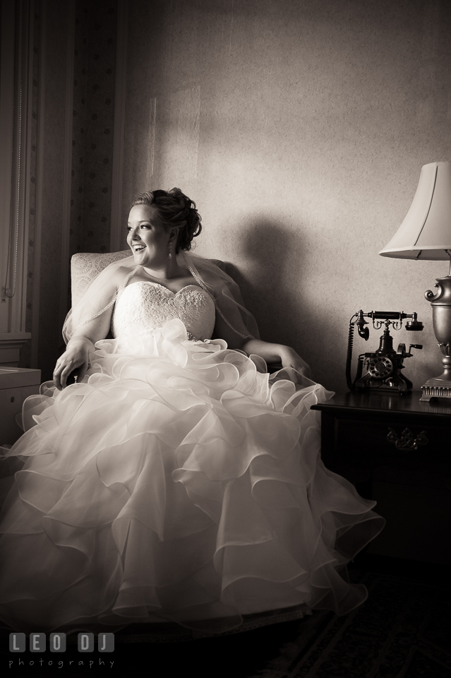 Beautiful bride sitting by the window, laughing. Kent Manor Inn, Kent Island, Eastern Shore Maryland, wedding ceremony and getting ready photos, by wedding photographers of Leo Dj Photography. http://leodjphoto.com