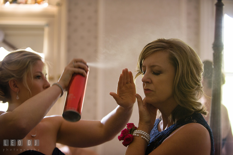 Bride's sister spraying hair spray on Mother's hair. Kent Manor Inn, Kent Island, Eastern Shore Maryland, wedding ceremony and getting ready photos, by wedding photographers of Leo Dj Photography. http://leodjphoto.com