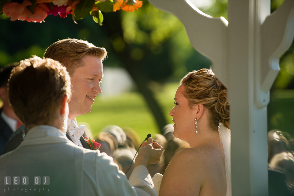 Bride and Groom reciting their vows and exchanging wedding rings. Kent Manor Inn, Kent Island, Eastern Shore Maryland, wedding ceremony and getting ready photos, by wedding photographers of Leo Dj Photography. http://leodjphoto.com