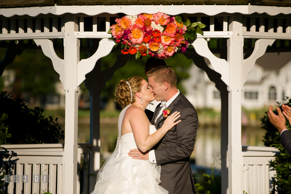 Bride and Groom kissing after pronounced as official husband and wife. Kent Manor Inn, Kent Island, Eastern Shore Maryland, wedding ceremony and getting ready photos, by wedding photographers of Leo Dj Photography. http://leodjphoto.com