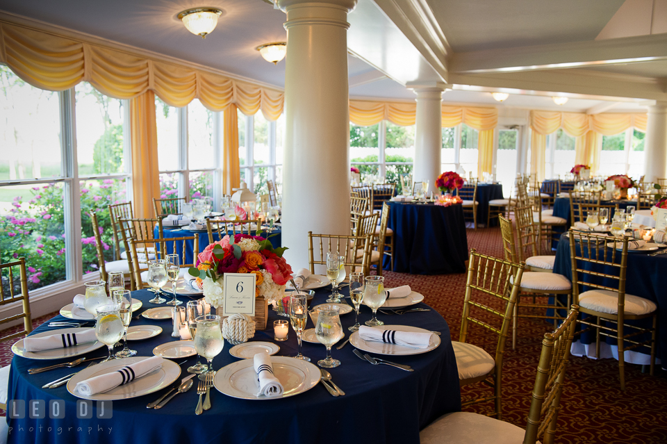 Table setting with the vibrant colored flowers for the centerpiece by Intrigue Design and Decor. Kent Manor Inn, Kent Island, Eastern Shore Maryland, wedding reception and ceremony photo, by wedding photographers of Leo Dj Photography. http://leodjphoto.com