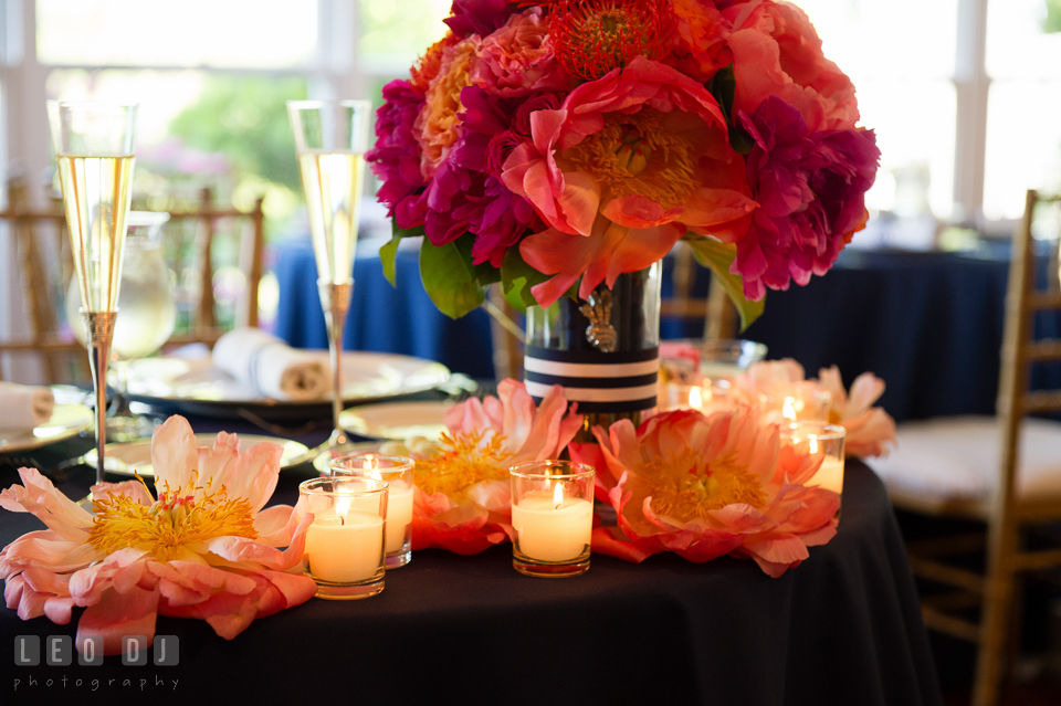 Peonies, candles, and Bride's flower bouquet on the sweetheart table. Kent Manor Inn, Kent Island, Eastern Shore Maryland, wedding reception and ceremony photo, by wedding photographers of Leo Dj Photography. http://leodjphoto.com