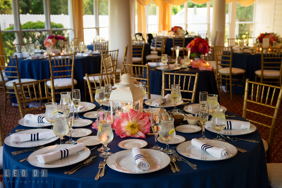 Table setting with large peonies and nautical lantern for the centerpiece by Intrigue Design and Decor. Kent Manor Inn, Kent Island, Eastern Shore Maryland, wedding reception and ceremony photo, by wedding photographers of Leo Dj Photography. http://leodjphoto.com