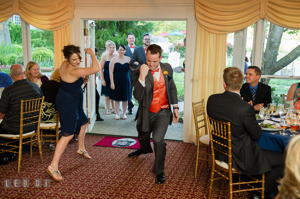 Groomsman and bridesmaid showing of fists and guns during introduction entrance. Kent Manor Inn, Kent Island, Eastern Shore Maryland, wedding reception and ceremony photo, by wedding photographers of Leo Dj Photography. http://leodjphoto.com