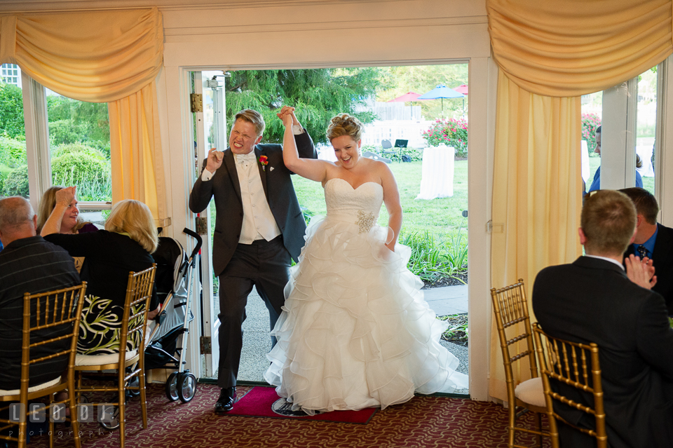 "Bride and Groom entering the ballroom during introduction, accompanied by their favorite tune, ""I Got a Feeling"" by the Black Eyed Peas. Kent Manor Inn, Kent Island, Eastern Shore Maryland, wedding reception and ceremony photo, by wedding photographers of Leo Dj Photography. http://leodjphoto.com"