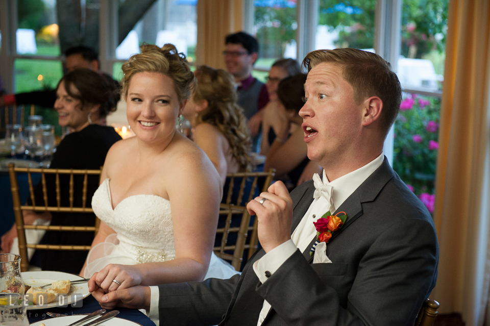 Bride and Groom smiling and commenting Matron of Honor's toast speech. Kent Manor Inn, Kent Island, Eastern Shore Maryland, wedding reception and ceremony photo, by wedding photographers of Leo Dj Photography. http://leodjphoto.com