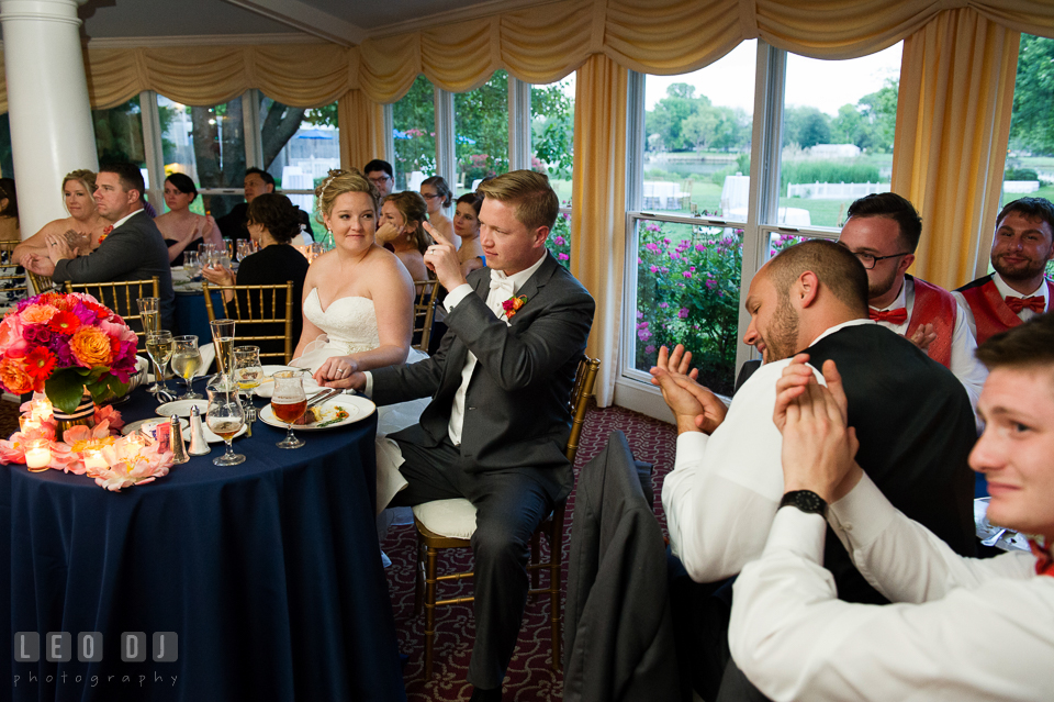 Guests clapping hands as Best Man delivered his speech. Kent Manor Inn, Kent Island, Eastern Shore Maryland, wedding reception and ceremony photo, by wedding photographers of Leo Dj Photography. http://leodjphoto.com