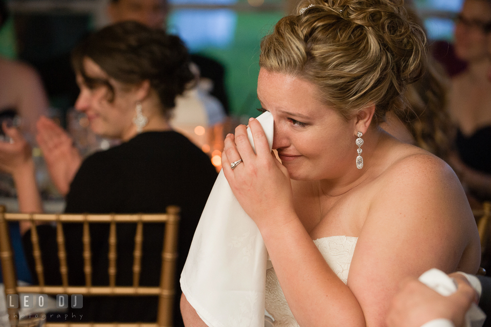 Bride wiping tears, touched by Best Man's toast speech. Kent Manor Inn, Kent Island, Eastern Shore Maryland, wedding reception and ceremony photo, by wedding photographers of Leo Dj Photography. http://leodjphoto.com