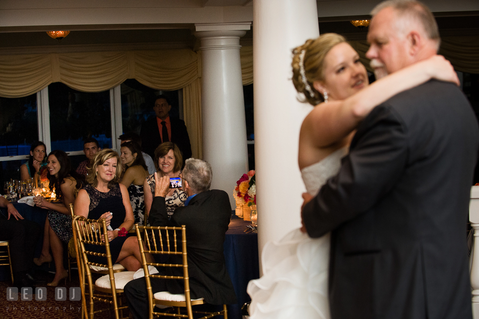 Mother of Bride seeing her husband and daughter dancing during the father-daughter dance. Kent Manor Inn, Kent Island, Eastern Shore Maryland, wedding reception and ceremony photo, by wedding photographers of Leo Dj Photography. http://leodjphoto.com