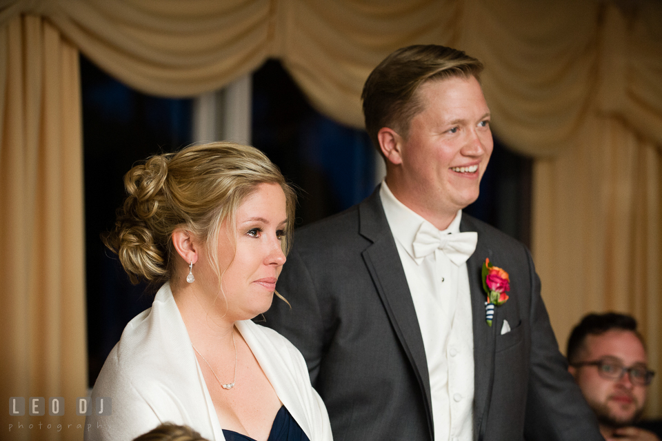 Sister of Bride and Groom smiling and shedding tear watching Bride danced with father. Kent Manor Inn, Kent Island, Eastern Shore Maryland, wedding reception and ceremony photo, by wedding photographers of Leo Dj Photography. http://leodjphoto.com