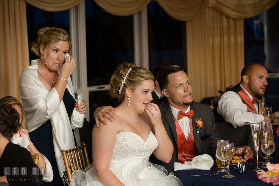 The teary-eyed Bride, her sister and the Groom's brother during the Mother and son. Kent Manor Inn, Kent Island, Eastern Shore Maryland, wedding reception and ceremony photo, by wedding photographers of Leo Dj Photography. http://leodjphoto.com