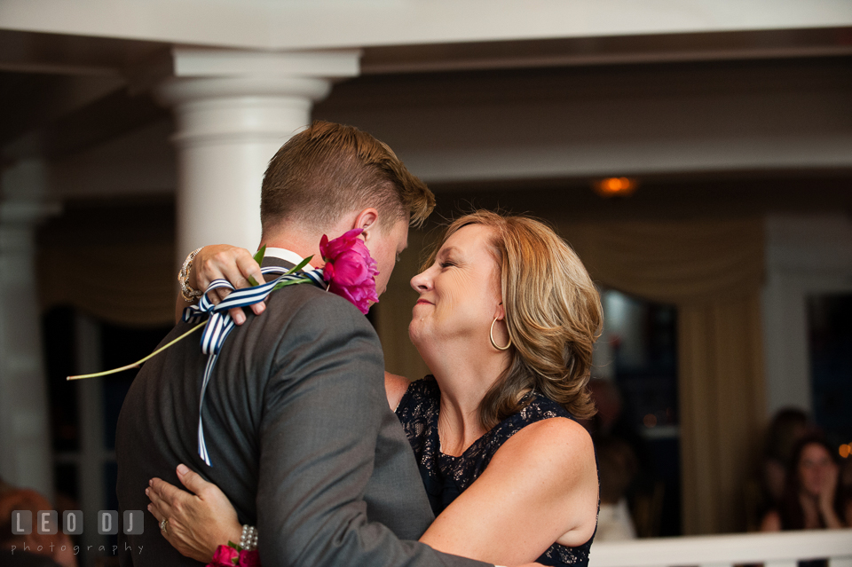 The Mother of the Groom holding a single red rose during the parent dance. Kent Manor Inn, Kent Island, Eastern Shore Maryland, wedding reception and ceremony photo, by wedding photographers of Leo Dj Photography. http://leodjphoto.com