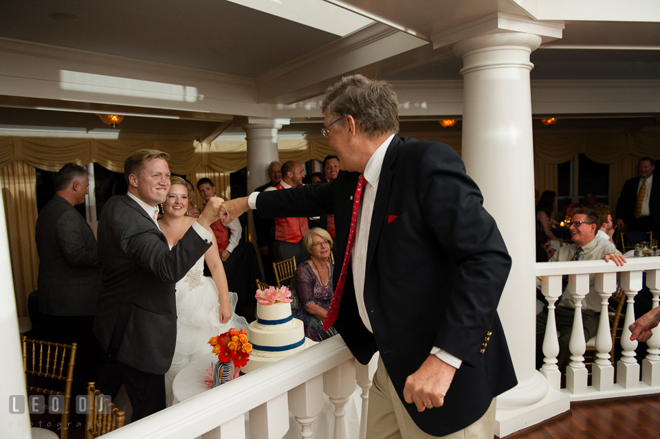 The Bride and Groom being congratulated by guests. Kent Manor Inn, Kent Island, Eastern Shore Maryland, wedding reception and ceremony photo, by wedding photographers of Leo Dj Photography. http://leodjphoto.com
