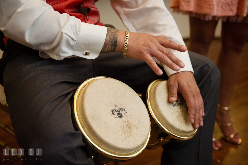 Best man playing bongo drums for the Bride and Groom. Kent Manor Inn, Kent Island, Eastern Shore Maryland, wedding reception and ceremony photo, by wedding photographers of Leo Dj Photography. http://leodjphoto.com