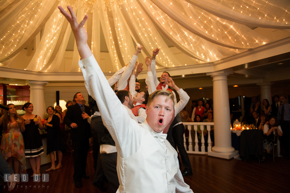 Groom tossed garter and caught by one of the groomsmen. Kent Manor Inn, Kent Island, Eastern Shore Maryland, wedding reception and ceremony photo, by wedding photographers of Leo Dj Photography. http://leodjphoto.com