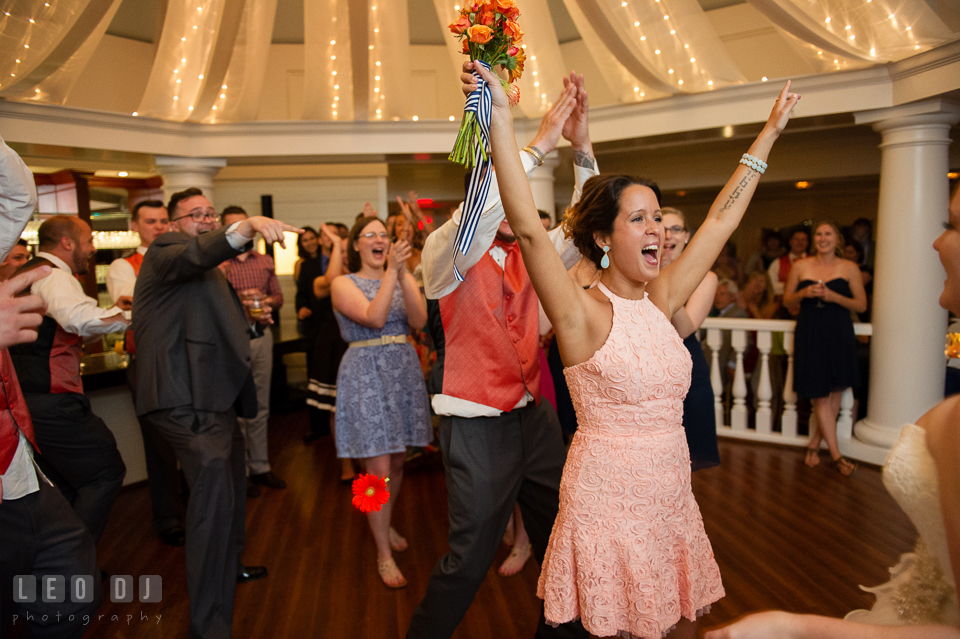 One of the guests cheered after she caught the flower bouqet the bride threw. Kent Manor Inn, Kent Island, Eastern Shore Maryland, wedding reception and ceremony photo, by wedding photographers of Leo Dj Photography. http://leodjphoto.com