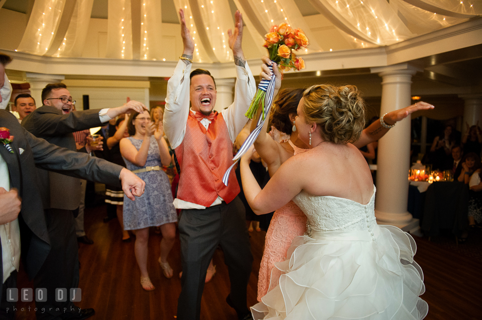 Bride hugged girl that caught the bouquet and Best Man cheered. Kent Manor Inn, Kent Island, Eastern Shore Maryland, wedding reception and ceremony photo, by wedding photographers of Leo Dj Photography. http://leodjphoto.com