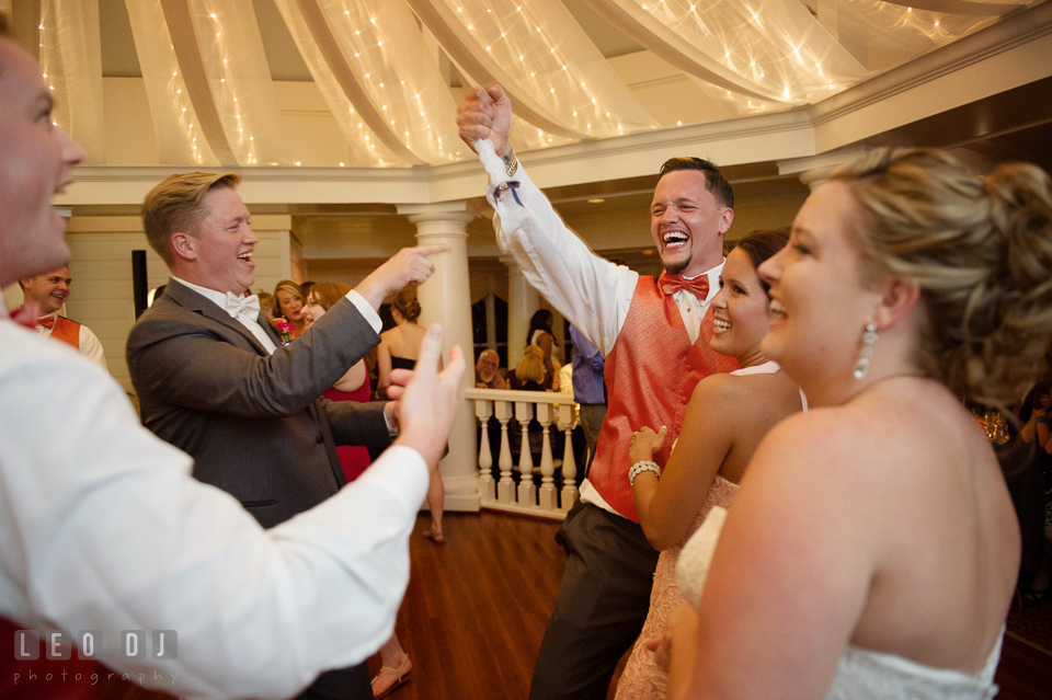 Best Man cheered after Groomsmen gave garter to him. Kent Manor Inn, Kent Island, Eastern Shore Maryland, wedding reception and ceremony photo, by wedding photographers of Leo Dj Photography. http://leodjphoto.com