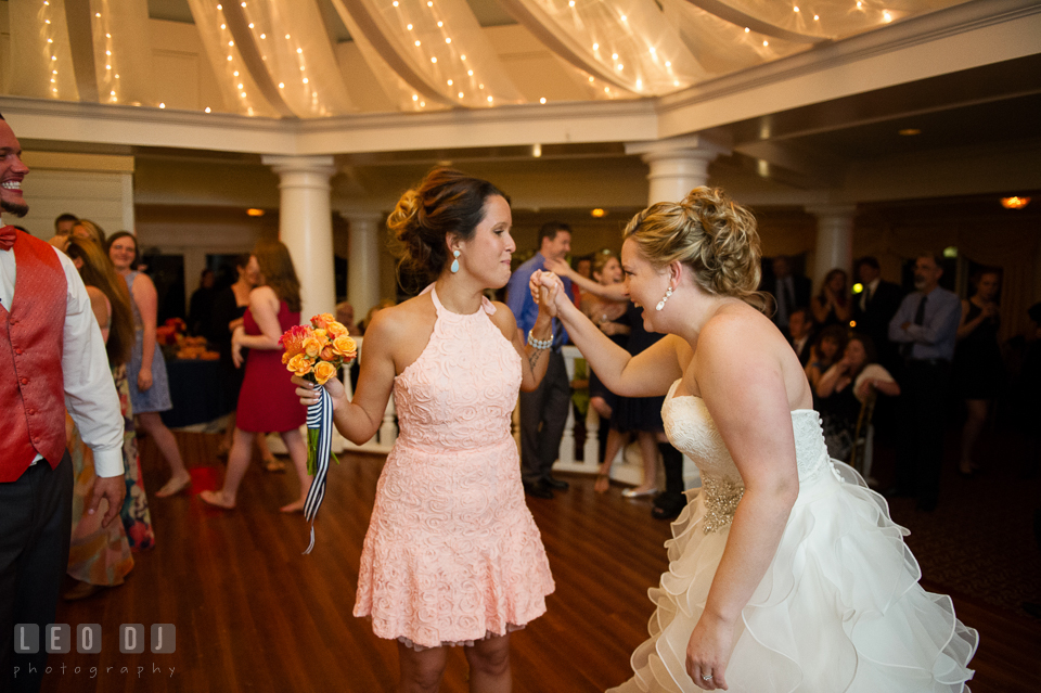 Bride congratulated the winner of bouquet tossing. Kent Manor Inn, Kent Island, Eastern Shore Maryland, wedding reception and ceremony photo, by wedding photographers of Leo Dj Photography. http://leodjphoto.com