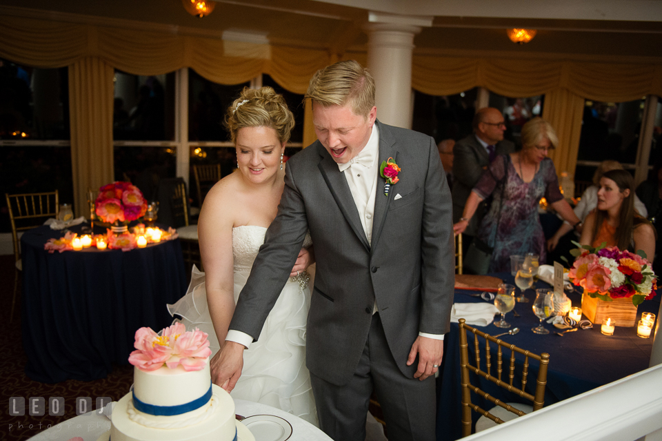 Bride and Groom cutting wedding cake by Sugar Bakers. Kent Manor Inn, Kent Island, Eastern Shore Maryland, wedding reception and ceremony photo, by wedding photographers of Leo Dj Photography. http://leodjphoto.com