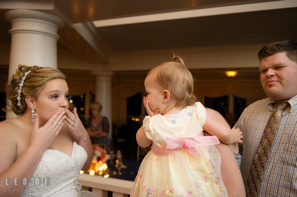 Bride and baby trying to blow kisses together. Kent Manor Inn, Kent Island, Eastern Shore Maryland, wedding reception and ceremony photo, by wedding photographers of Leo Dj Photography. http://leodjphoto.com