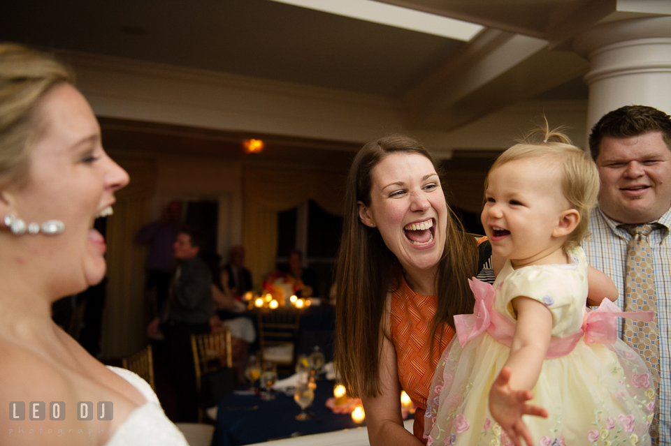 Baby, her mother, and Bride laughing after baby blew kiss. Kent Manor Inn, Kent Island, Eastern Shore Maryland, wedding reception and ceremony photo, by wedding photographers of Leo Dj Photography. http://leodjphoto.com