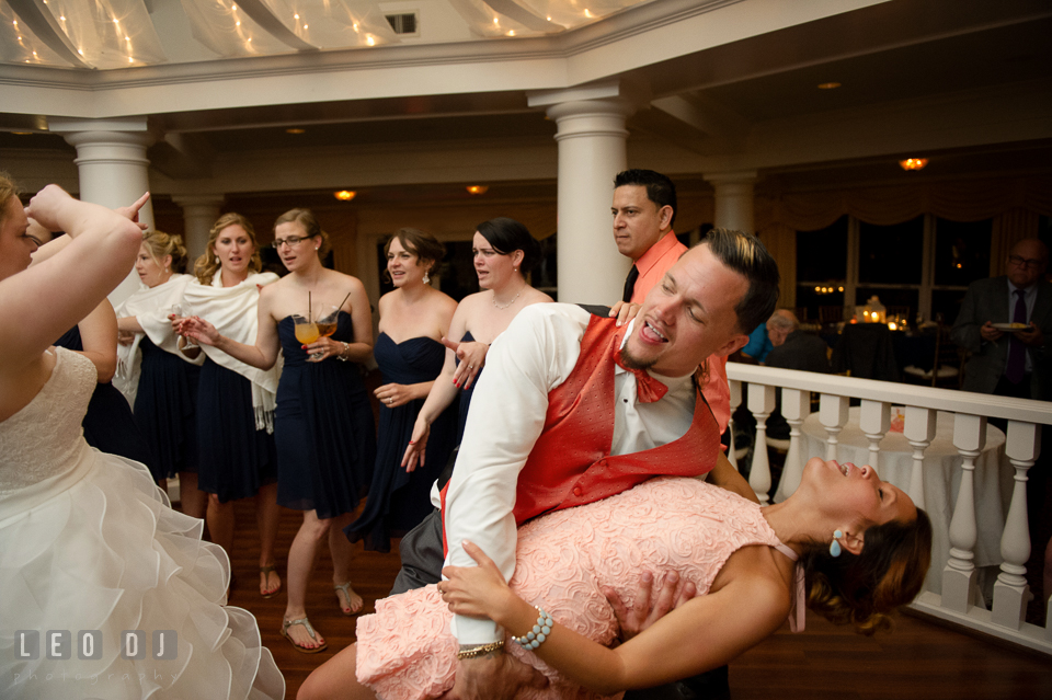 Best man doing the dip to girlfriend during open floor dance. Kent Manor Inn, Kent Island, Eastern Shore Maryland, wedding reception and ceremony photo, by wedding photographers of Leo Dj Photography. http://leodjphoto.com