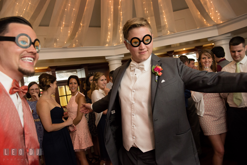 Groom and best man dancing with silly glasses. Kent Manor Inn, Kent Island, Eastern Shore Maryland, wedding reception and ceremony photo, by wedding photographers of Leo Dj Photography. http://leodjphoto.com