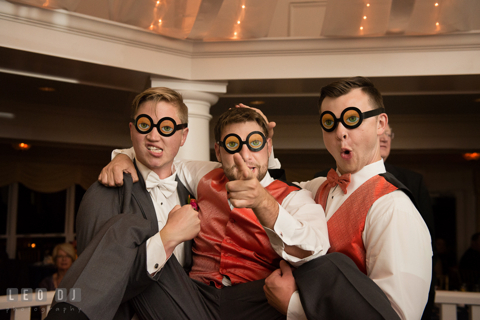 Groom and groomsmen posing silly with silly eye glasses. Kent Manor Inn, Kent Island, Eastern Shore Maryland, wedding reception and ceremony photo, by wedding photographers of Leo Dj Photography. http://leodjphoto.com