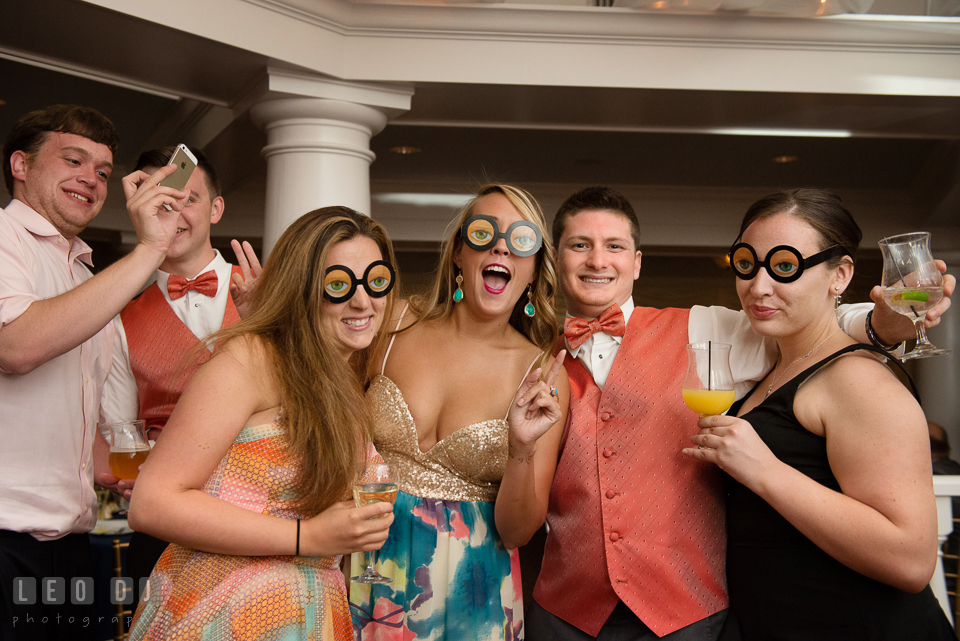 Guests having fun posing with silly glasses. Kent Manor Inn, Kent Island, Eastern Shore Maryland, wedding reception and ceremony photo, by wedding photographers of Leo Dj Photography. http://leodjphoto.com