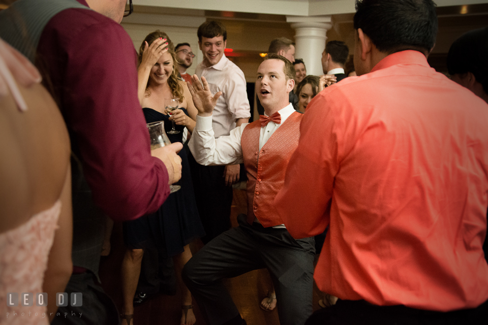 Groomsmen showing silly dance, guests laughing. Kent Manor Inn, Kent Island, Eastern Shore Maryland, wedding reception and ceremony photo, by wedding photographers of Leo Dj Photography. http://leodjphoto.com