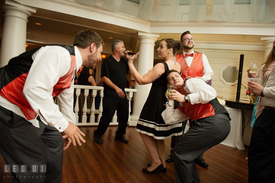 Groomsmen and guests dancing silly and having fun. Kent Manor Inn, Kent Island, Eastern Shore Maryland, wedding reception and ceremony photo, by wedding photographers of Leo Dj Photography. http://leodjphoto.com
