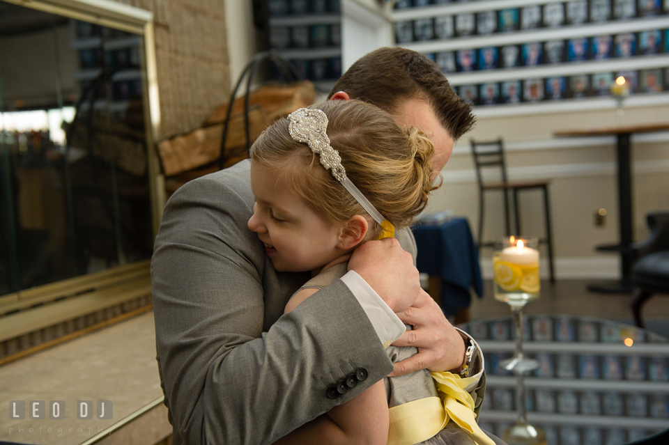 Groom hugging flower girl. Maryland Yacht Club wedding at Pasadena Maryland, by wedding photographers of Leo Dj Photography. http://leodjphoto.com