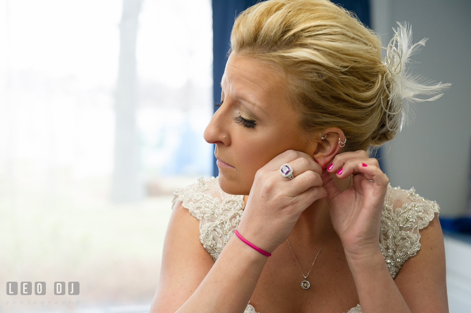 Bride getting ready and putting on earrings. Maryland Yacht Club wedding at Pasadena Maryland, by wedding photographers of Leo Dj Photography. http://leodjphoto.com
