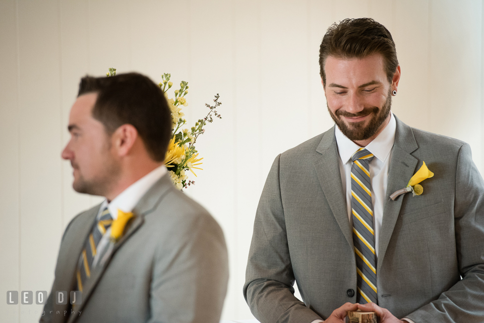 Best man smiling listening to the vows. Maryland Yacht Club wedding at Pasadena Maryland, by wedding photographers of Leo Dj Photography. http://leodjphoto.com