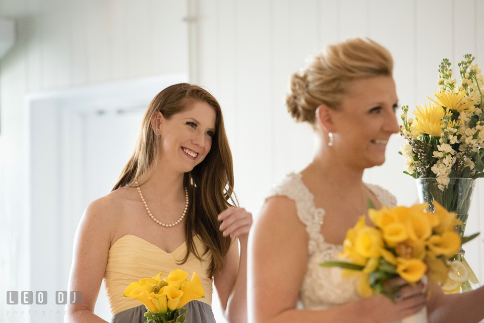 Maid of Honor laughing during the vows. Maryland Yacht Club wedding at Pasadena Maryland, by wedding photographers of Leo Dj Photography. http://leodjphoto.com