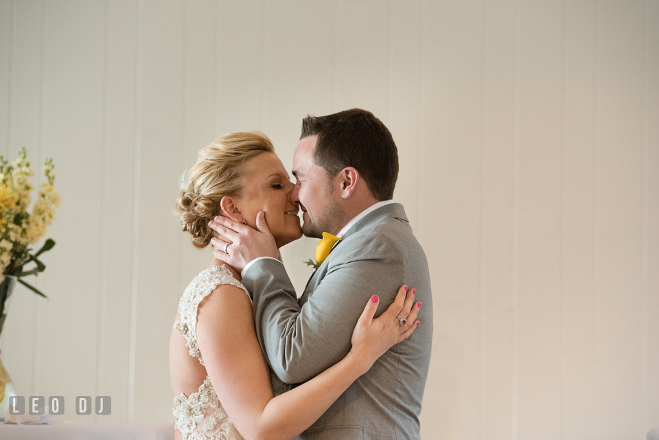 Bride and Groom's first kiss during the ceremony. Maryland Yacht Club wedding at Pasadena Maryland, by wedding photographers of Leo Dj Photography. http://leodjphoto.com