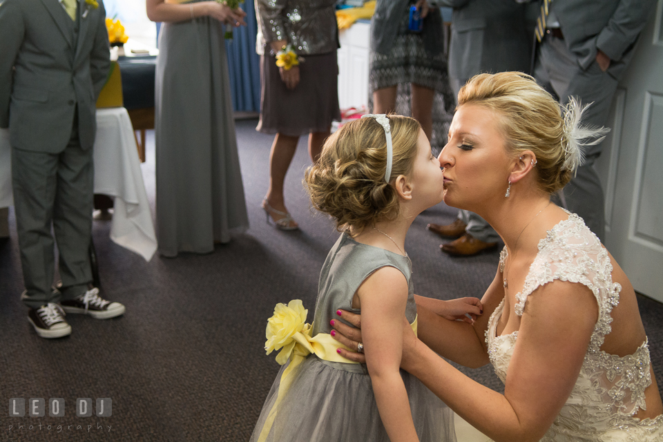 Bride kissing her daughter. Maryland Yacht Club wedding at Pasadena Maryland, by wedding photographers of Leo Dj Photography. http://leodjphoto.com