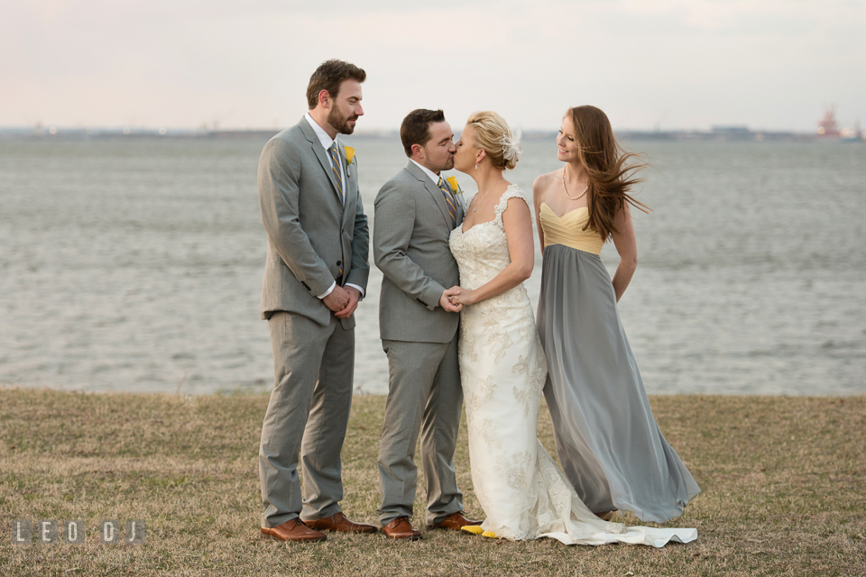 Best Man and Maid of Honor watching the Bride and Groom kissing during the wedding party outdoor photo session. Maryland Yacht Club wedding at Pasadena Maryland, by wedding photographers of Leo Dj Photography. http://leodjphoto.com