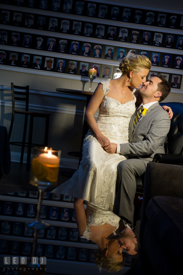 Bride and Groom sitting, cuddling and kissing. Maryland Yacht Club wedding at Pasadena Maryland, by wedding photographers of Leo Dj Photography. http://leodjphoto.com
