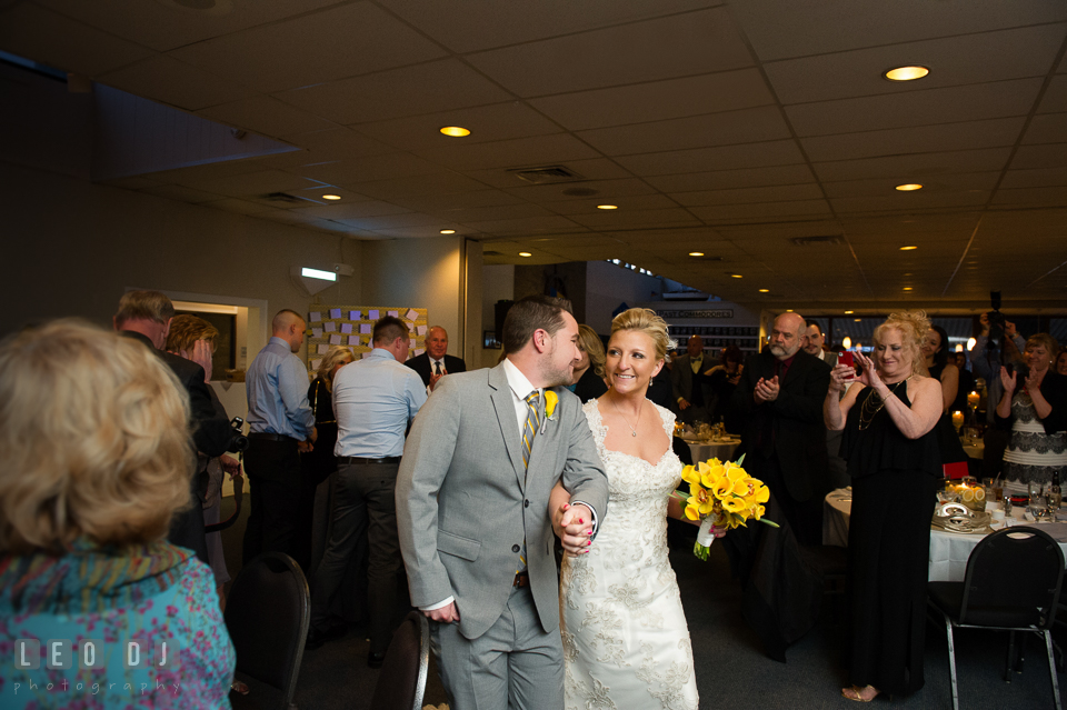 Bride and Groom entering the dining room during the introduction by the DJ. Maryland Yacht Club wedding at Pasadena Maryland, by wedding photographers of Leo Dj Photography. http://leodjphoto.com