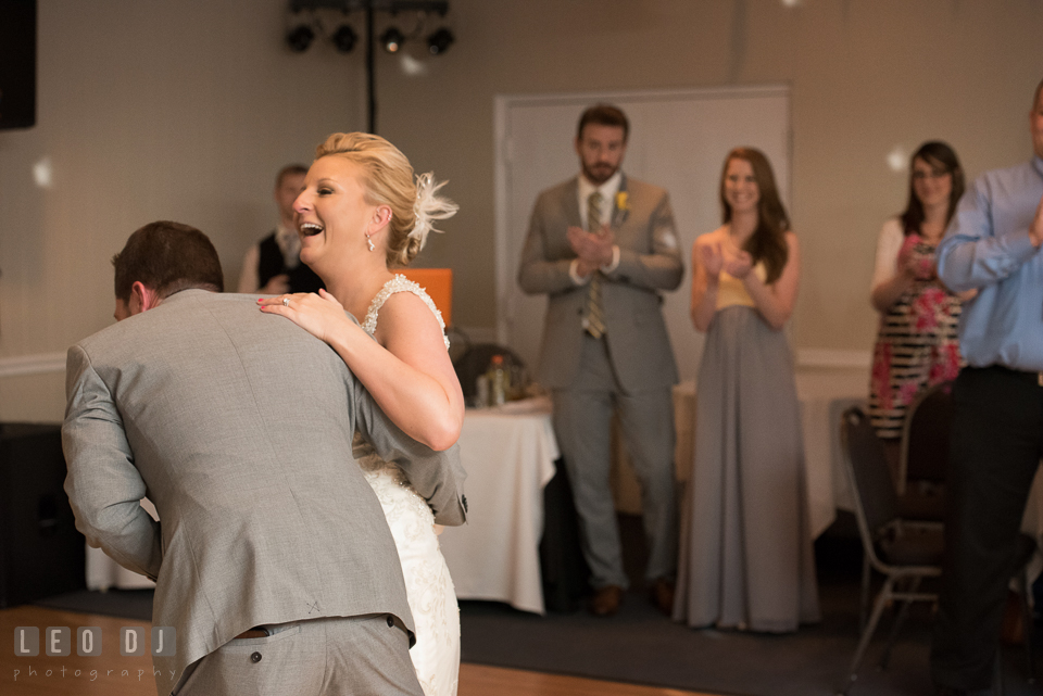 Bride and Groom laughing during their first dance. Maryland Yacht Club wedding at Pasadena Maryland, by wedding photographers of Leo Dj Photography. http://leodjphoto.com