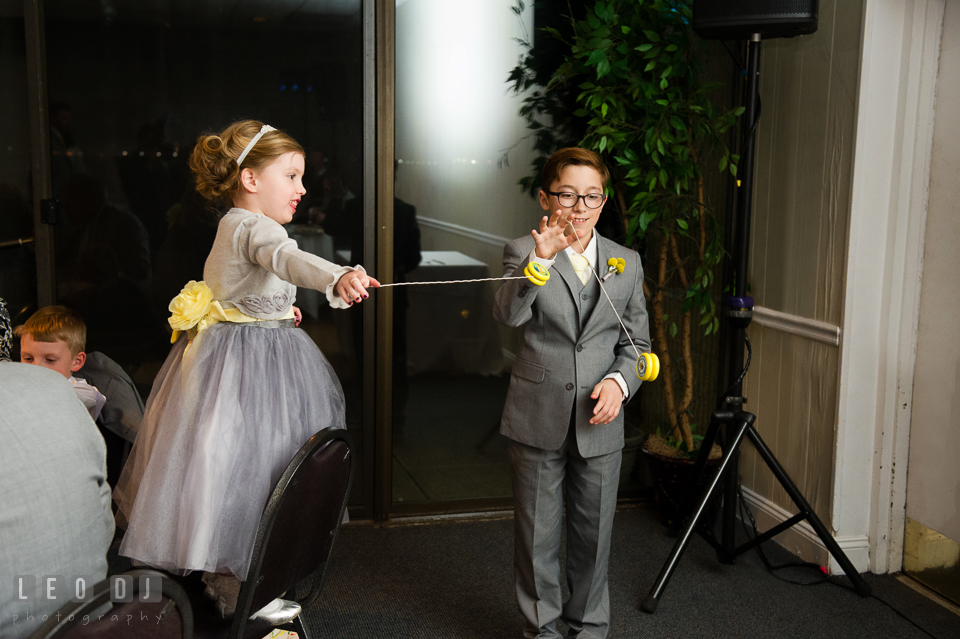 Ring bearer boy and flower girl playing yo-yo. Maryland Yacht Club wedding at Pasadena Maryland, by wedding photographers of Leo Dj Photography. http://leodjphoto.com