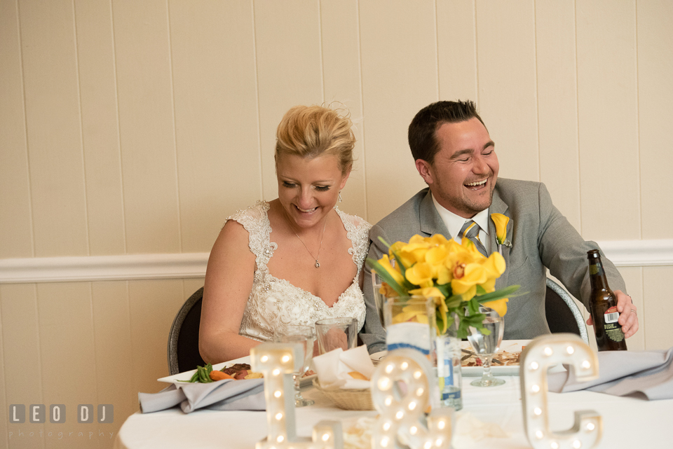 Bride and Groom laughing listening to toast speech from the Maid of Honor and Best Man. Maryland Yacht Club wedding at Pasadena Maryland, by wedding photographers of Leo Dj Photography. http://leodjphoto.com