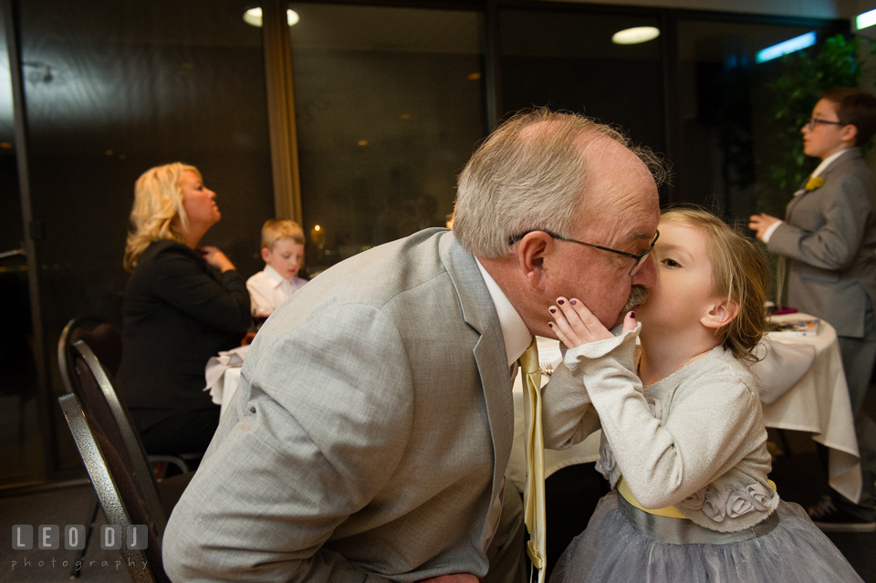 Father of the Bride kissed by his granddaughter. Maryland Yacht Club wedding at Pasadena Maryland, by wedding photographers of Leo Dj Photography. http://leodjphoto.com